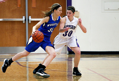 Sarah Nader- snader@shawmedia.com Woodstock's Dakota Brand (left) is guarded by Hampshire's Tricia Dumoulin while she brings the ball towards the basket during the first quarter of Wednesday's game in Hampshire February 5, 2014. Hampshire defeated Woodstock, 58-36.