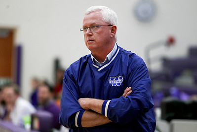 Sarah Nader- snader@shawmedia.com Woodstock's head basketball coach Martin Hammond watches Wednesday's game against Hampshire on February 5, 2014. Hampshire defeated Woodstock, 58-36.
