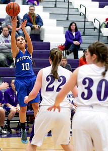 Sarah Nader- snader@shawmedia.com Woodstock's Megan Pautrat shoots during the third quarter of Wednesday's game against Hampshire February 5, 2014. Hampshire defeated Woodstock, 58-36.