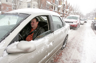 H. Rick Bamman - hbamman@shawmedia.com Frank Barrile of Cary sits in traffic on North Harrison St. in Algonquin Wed, Feb. 5, 2014.  Barrile said it took him 40 minutes to get to downtown Algonquin from Cary after traffic was diverted off of Rt. 31.