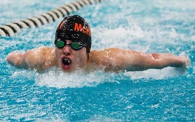 Kyle Grillot - kgrillot@shawmedia.com   McHenry's Trey Schopen rests after finishing the 100-yard butterfly Thursday at McHenry. Schopen won the event with a time of 55.03, Cary-Grove won the meet, 88-82.