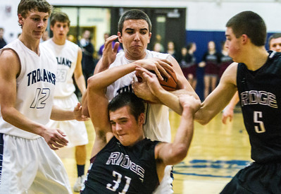 Kyle Grillot - kgrillot@shawmedia.com   Cary-Grove juniors Tyler Szydlo and Prairie Ridge junior Jack Berg fight for a lose ball during the third quarter of the boys basketball Friday in Cary. Cary-Grove beat Prairie Ridge, 47-38.