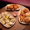 (Clockwise, from bottom left) Baked clams, beef filet slider trio and Italian sub trio at A' Saluté martini lounge, located at 2400 E. Main St. in the Foxboro Plaza in St. Charles.