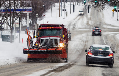 Kyle Grillot - kgrillot@shawmedia.com   A Crystal Lake public works truck plows East Crystal Lake Avenue as snow falls Saturday, Janurary 8, 2014. Around 3 inches of snow is expected Saturday and temperatures are expected to reach 20 degrees below zero with wind chills on Sunday and Monday.