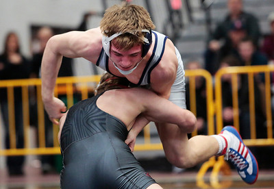 Kyle Grillot - kgrillot@shawmedia.com   Cary-Grove's Michael Cullen wrestles Deerfield's Andrew Mehrholz during the 120-pound championship match of the 3A Individual Regional Wrestling meet at McHenry High School Saturday, January 8, 2014. Cullen won the match, 4-3.