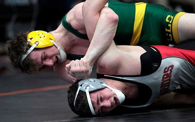 Kyle Grillot - kgrillot@shawmedia.com   Crystal Lake South's Eric Barone wrestles McHenry's Carter Herbert during a 145-pound championship semifinal of the 3A Individual Regional Wrestling meet at McHenry High School Saturday, January 8, 2014.