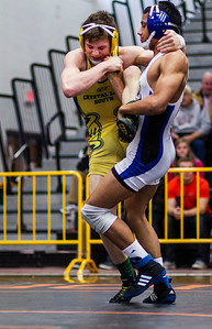Kyle Grillot - kgrillot@shawmedia.com   Crystal Lake South's Eric Barone (left) wrestles Lake Zurich's Brandon Arteaga during a 145-pound championship match of the 3A Individual Regional Wrestling meet at McHenry High School Saturday, January 8, 2014. Conrad won the match, 2-0.
