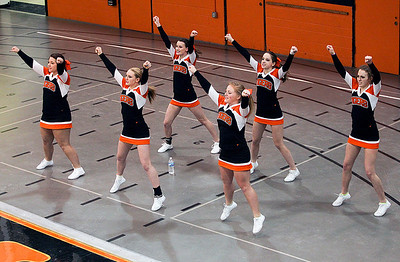 Sarah Nader- snader@shawmedia.com Crystal Lake Central cheerleaders cheer on the boys basketball team during Monday's game against Woodstock on February 10, 2014.
