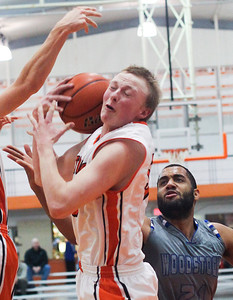Sarah Nader- snader@shawmedia.com Crystal Lake Central's Ian Koch (left) and Woodstock's Damian Stoneking reach for the rebound during the second quarter of Monday's game in Crystal Lake February 10, 2014. Crystal Lake Central defeated Woodstock, 45-41.