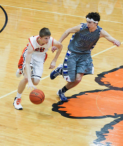 Sarah Nader- snader@shawmedia.com Crystal Lake Central's Jason Price (left) is guarded by Woodstock's Mitch Kohley during the fourth quarter of Monday's game in Crystal Lake February 10, 2014. Crystal Lake Central defeated Woodstock, 45-41.