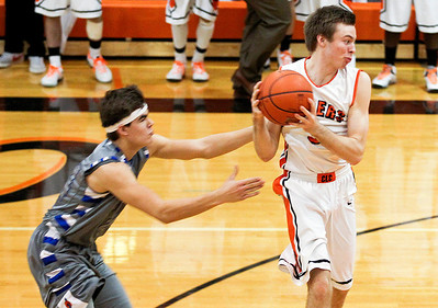 Sarah Nader- snader@shawmedia.com Woodstock's Zach Cullum (left) grabs at Crystal Lake Central's Kenny Vesely while he takes the ball towards the basket during the fourth quarter of Monday's game in Crystal Lake February 10, 2014. Crystal Lake Central defeated Woodstock, 45-41.
