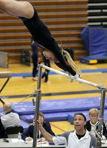 Jeff Krage – For Shaw Media Prairie Ridge's Maddie Solka competes on the uneven parallel bars during Monday's sectionals at Conant High School. Hoffman Estates 2/10/14