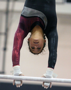 Jeff Krage – For Shaw Media Prairie Ridge's Kendall Rumford competes on the uneven parallel bars during Monday's sectionals at Conant High School. Hoffman Estates 2/10/14