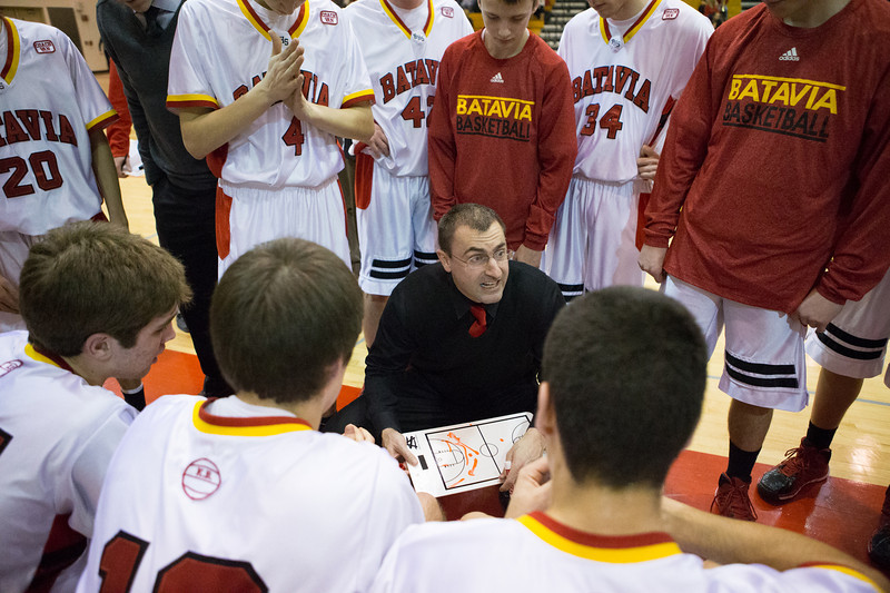Batavia's head coach Jim Nazos talks to his team during time out against St.Charles North at Batavia High School in Batavia, IL on Friday, February 07, 2014 (Sean King for Shaw Media)
