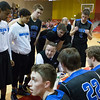 St.Charles North's head coach Tom Poulin talks to his team during a time out against Batavia at Batavia High School in Batavia, IL on Friday, February 07, 2014 (Sean King for Shaw Media)
