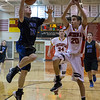 St.Charles North's David Pozna (13) drives to the hoop against Batavia's Mitchell McGregor (20) at Batavia High School in Batavia, IL on Friday, February 07, 2014 (Sean King for Shaw Media)