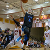St.Charles North's Jake Ludwig (2) drives to the hoop on a fast break against Batavia's Micah Coffey (14) at Batavia High School in Batavia, IL on Friday, February 07, 2014 (Sean King for Shaw Media)