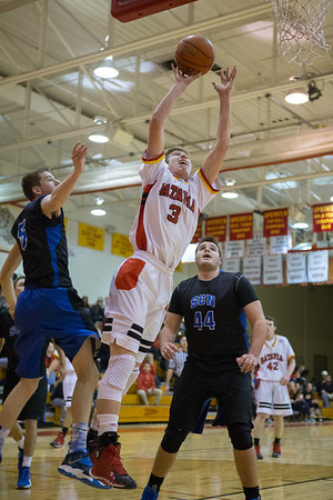 Batavia's Tucker Knox (3) takes the ball strong to the hoop against St.Charles North's Tyler DeMoss (5) and Chase Gianacakos (44) at Batavia High School in Batavia, IL on Friday, February 07, 2014 (Sean King for Shaw Media)