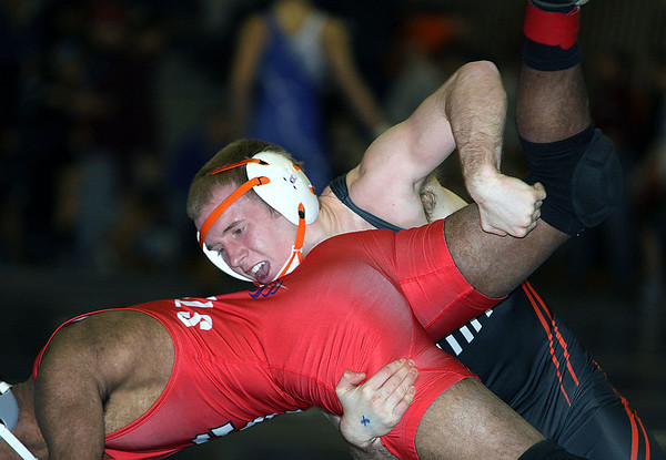 Jeff Krage – For Shaw Media<br /> St. Charles East's Jake Mende wrestles with South Elgin's Nikel Wiliby in a 145-pound match during Saturday's IHSA class 3A regional at South Elgin High School.<br /> South Elgin 2/8/14
