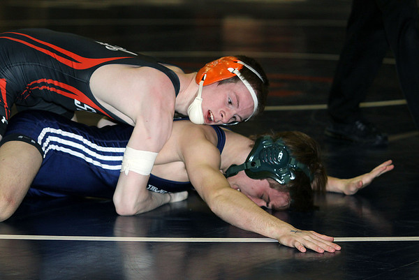 Jeff Krage – For Shaw Media<br /> St. Charles East's Quinn Doherty (top) wrestles with Bartlett's Brandon Johnson in a 126-pound match during Saturday's IHSA class 3A regional at South Elgin High School.<br /> South Elgin 2/8/14
