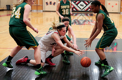 Kyle Grillot - kgrillot@shawmedia.com   Huntley sophomore Ali Andrews (center) and Crystal Lake South senior Rachel Rasmussen (behind) go for a loose ball during the third quarter of the girls basketball game Tuesday in Huntley. Huntley beat Crystal Lake South, 61-50.