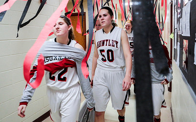 Kyle Grillot - kgrillot@shawmedia.com   Huntley sophomores Paige Renkosik (22) and Ali Andrews (50) walk towards the locker room after the end of the girls basketball game Tuesday in Huntley. Huntley beat Crystal Lake South, 61-50.
