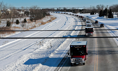 Kyle Grillot - kgrillot@shawmedia.com   The procession advances north on Route 14 in Woodstock. The visitation was held at the Woodstock Assembly of God Church, and the procession traveled by each of three Woodstock fire stations. Wurtz ended his battle with cancer yesterday afternoon while surrounded by family and friends. Mike is survived by his wife, three daughters and two step-children.