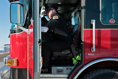Kyle Grillot - kgrillot@shawmedia.com   Woodstock firefighter Andy Harding enters a truck after the completion of the procession. The visitation was held at the Woodstock Assembly of God Church, and the procession traveled by each of three Woodstock fire stations. Wurtz ended his battle with cancer yesterday afternoon while surrounded by family and friends. Mike is survived by his wife, three daughters and two step-children.
