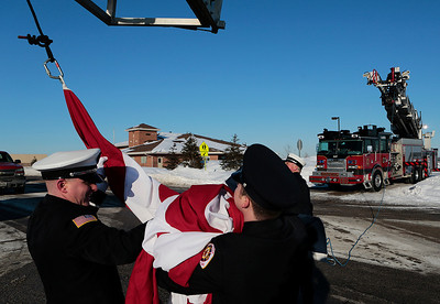 Kyle Grillot - kgrillot@shawmedia.com   Woodstock firefighters gather the American flag at the end of the procession. The visitation was held at the Woodstock Assembly of God Church, and the procession traveled by each of three Woodstock fire stations. Wurtz ended his battle with cancer yesterday afternoon while surrounded by family and friends. Mike is survived by his wife, three daughters and two step-children.