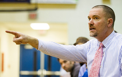 Kyle Grillot - kgrillot@shawmedia.com   Woodstock's head coach Alex Baker directs his players during the fourth quarter of the boys basketball game Wednesday in Woodstock. Woodstock North beat Woodstock, 61-58.