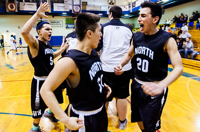 Kyle Grillot - kgrillot@shawmedia.com   Woodstock North's Riley Basaran (20) celebrates with Vic Ortiz (31) and Leonel Ortiz (5) after the end of the boys basketball game Wednesday in Woodstock. Woodstock North beat Woodstock, 61-58.