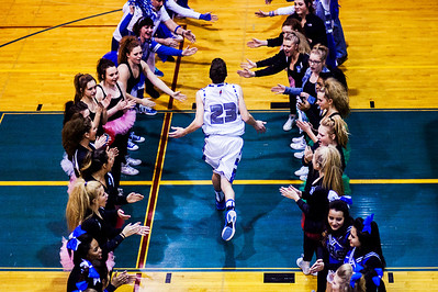 Kyle Grillot - kgrillot@shawmedia.com   Woodstock's Mike Chonos is greeted by students and fans before the start of the boys basketball game Wednesday in Woodstock. Woodstock North beat Woodstock, 61-58.