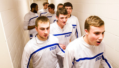 Kyle Grillot - kgrillot@shawmedia.com   Woodstock players enter the court before the start of the boys basketball game Wednesday in Woodstock. Woodstock North beat Woodstock, 61-58.