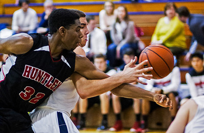 Kyle Grillot - kgrillot@shawmedia.com   Huntley senior Amanze Egekeze and Cary-Grove senior Tyler Szdlo fight for a rebound during the fourth quarter of the boys basketball game Thursday in Cary. Cary-Grove beat Huntley, 51-48.
