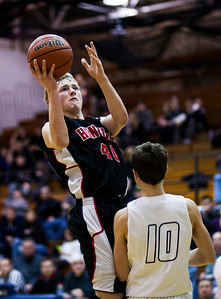 Kyle Grillot - kgrillot@shawmedia.com   Huntley junior Brendan Boesch (40) puts up a shot under pressure from Cary-Grove senior Devin McDonough during the fourth quarter of the boys basketball game Thursday in Cary. Cary-Grove beat Huntley, 51-48.