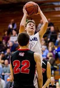 Kyle Grillot - kgrillot@shawmedia.com   Cary-Grove junior Jason Gregoire puts up a shot under pressure from Huntley junior Connor Boesch during the second quarter of the boys basketball game Thursday in Cary. Cary-Grove beat Huntley, 51-48.
