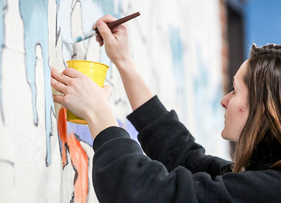 Sarah Nader- snader@shawmedia.com Leanne Johns, 20, of McHenry helps paint graffiti inspired mural that was started by Chicago artist Nino Rodriguez at MCC in Crystal Lake Thursday, February 13, 2014.