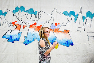 Sarah Nader- snader@shawmedia.com In-between classes McHenry County College student Laurissa Mortensen, 18, of Genoa City Wis., helps paint a graffiti inspired mural that was started by Chicago artist Nino Rodriguez at MCC in Crystal Lake Thursday, February 13, 2014. The event showcased art and photos along with discussions about the popular worldwide phenomenon know as graffiti art. Students and staff had the opportunity to help complete the graffiti mural in the commons area.
