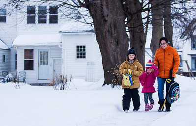 Kyle Grillot - kgrillot@shawmedia.com   Danielle Babineau of Crystal Lake (right) walks her great niece Emma Hartwig, 4, and grandson Sandy Babineau, 8, home from the bus stop along 3rd Street Thursday in Crystal Lake.