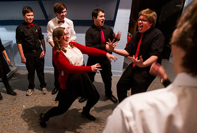 "Kyle Grillot - kgrillot@shawmedia.com   Crystal Lake Central sophomore Macky Leech (center) warms up with the improve group including Nick Desbiens, (from left) John Saltz, J.D. Fuerholzer, and Will Olsen before the start of the Valentines Day Improv show ""An Improv-er's Guide to Love and Heartbreak,"" Friday in Crystal Lake."