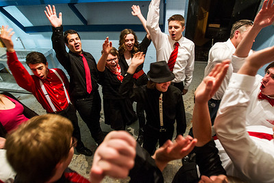 "Kyle Grillot - kgrillot@shawmedia.com    The Crystal Lake Central improve group throw their hand in the air before the start of the Valentines Day Improv show ""An Improv-er's Guide to Love and Heartbreak,"" Friday in Crystal Lake."
