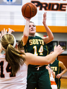 Kyle Grillot - kgrillot@shawmedia.com   Crystal Lake South sophomore Chanel Fanter (right) puts up a shot under pressure from Crystal Lake Central Shannon Ellman during the third quarter of the girls basketball game Friday in Crystal Lake. Crystal Lake South beat Crystal Lake Central, 51-42.
