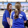 St. Charles North bowlers Ashley Montgomery (left) and Bobbi Jo Buhlman share a laugh during a practice Wednesday at St. Charles Bowl.
