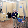 Dovie Jones, 78, of St. Charles Township works in the ladies' fitting room area of the Batavia Wal-Mart on her second-to-last day of work Thursday.