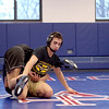 Marmion senior Johnny Jimenez (right), of St. Charles, wrestles teammate Eli Baltazar during a practice at the Aurora school Wednesday. Jimenez won three state championships in his first three seasons. He's preparing for the sectional meet that would give him a chance at his fourth title.