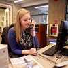 Megan Murtaugh, 17, of St. Charles answers a phone call while working the front desk at the Pottawatomie Community Center in St. Charles.