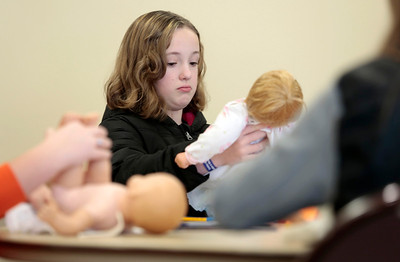 Kyle Grillot - kgrillot@shawmedia.com  Jessi Hyde, 11, of Cary puts a diaper on a baby doll during the Safe Sitter Babysitting Training Course Saturday at the Cary Community Center. The course, taught 3 weekends out of the month at various park districts, offers children ages 11-15 to learn the skills necessary for safe childcare. Some of the topics covered include ethics, safety, first aid, feeding infants, allergies, emergencies, ethics, and behavior management. A babysitting manual and completion card are included with the course.