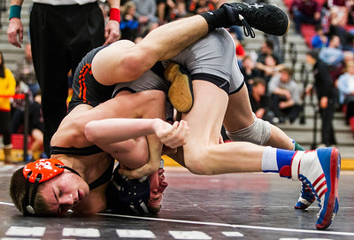 Kyle Grillot - kgrillot@shawmedia.com   Cary Grove sophomore John Cullen (right) wrestles Dekalb junior Jackson Montgomery during the 132-pound third place match of the class 3A Individual Sectional at Barrington High School Saturday, February 15, 2014. Cullen won the match, 3-2.