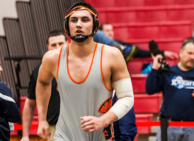 Kyle Grillot - kgrillot@shawmedia.com   McHenry senior Luis Hernandez reacts after winning the 220-pound third place match of the class 3A Individual Sectional at Barrington High School Saturday, February 15, 2014.