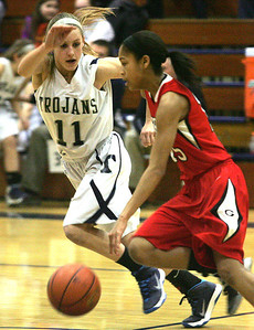 H. Rick Bamman - hbamman@shawmedia.com  Cary-Grove's Candace Cunningham (11) guards Grant's Jasmine Sangster (15) in the first half of the Class 4A regional on Monday, Feb. 17, 2014. Cary-Grove won 60-28.